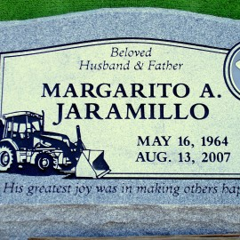 """A gray granite slant grave marker, 24"""" wide and 16"""" tall. Has a stainless steel/porcelain photo."""